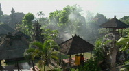 Stock Video Footage of Smoke rises from the middle of the Balinese village in Indonesia.