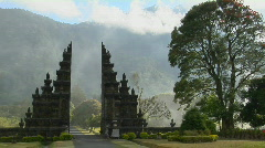 Fog drifts by a traditional Balinese temple gate in Bali, Indonesia. Stock Footage
