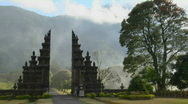 Stock Video Footage of Fog drifts by a traditional Balinese temple gate in Bali, Indonesia.