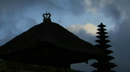 Stock Video Footage of A Balinese temple stands in silhouette.