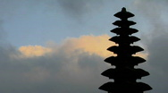 Stock Video Footage of Part of a Balinese temple stands in silhouette.