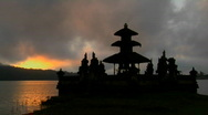 Stock Video Footage of A Balinese temple overlooks reflections in a lake.