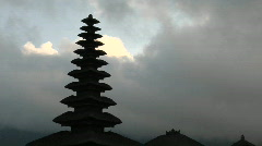 A Balinese temple stands silhouetted against a cloudy sky. Stock Footage