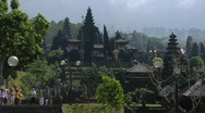 Stock Video Footage of Visitors approach a Balinese temple complex.