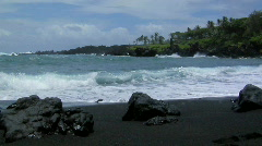 Large waves roll into a black sand beach. Stock Footage