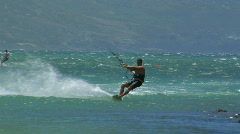 A windsurfer glides across a sparkling ocean. Stock Footage
