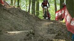 Cyclists race down rough terrain. Stock Footage