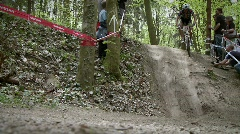 A group of bikers race down an off road trail. Stock Footage