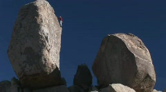 A climber begins to descend a rock face. Stock Footage