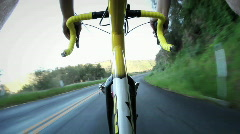 A person rides a bicycle down a rural highway. Stock Footage