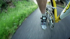 A bicyclist rides down a road. Stock Footage