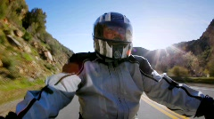 A man rides a motorcycle in the country side. Stock Footage