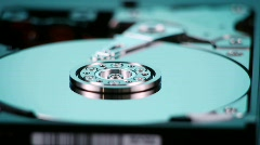 A hard drive with out cover spins slowly on display. Stock Footage