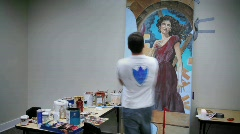 An artist works on a painting. Stock Footage