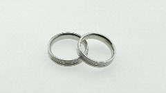 Silver wedding rings overlap each other. Stock Footage
