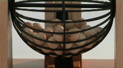 Close-up of bingo balls spinning in a bingo cage. Stock Footage