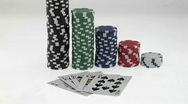 Stock Video Footage of Stacks of poker chips sit in a row, arranged by value