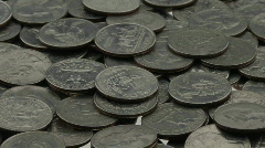 Quarters lay in a pile on a white surface. Stock Footage