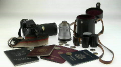Travel and photography equipment sit on a white surface. Stock Footage