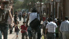 Slow move out on pedestrians in San Pedro de Atacama, Chile. Stock Footage