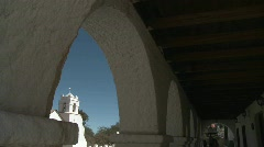 Vertical pan of the Iglesia San Pedro framed in the arches Stock Footage