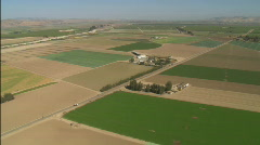 Helicopter aerial of farmland in the Salinas Valley, California. - stock footage