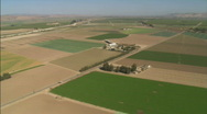 Stock Video Footage of Helicopter aerial of farmland in the Salinas Valley, California.
