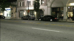 Cars speed down a city street. Stock Footage