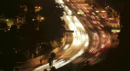 Stock Video Footage of Traffic moves along a Las Vegas street at night.