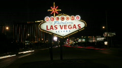 "The famous ""Welcome to Fabulous Las Vegas"" sign lights up Stock Footage"
