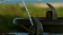 Water fountains emit spurts of water alternately. Stock Footage