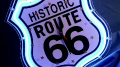 "Clock hands spin on a neon Historic Route 66"" clock face."" Stock Footage"