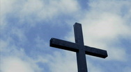 Clouds move in the sky above a wooden cross. Stock Footage