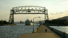 Time lapse of ship passing under lift bridge and bridge Stock Footage