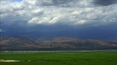 Time-lapse of rainclouds over mountains. - stock footage