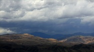 Stock Video Footage of Time-lapse of rainclouds over mountains.