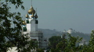 Stock Video Footage of Golden onion domes adorn the exterior of a Russian-style building.