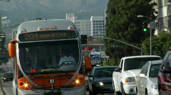A metro bus moves through heavy traffic. Stock Footage