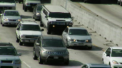 Heavy traffic moves slowly along a three-lane highway. - stock footage