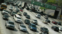 Traffic moves slowly along a busy freeway in Los Angeles. Stock Footage