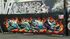Graffiti decorates the wall of a building. Stock Footage