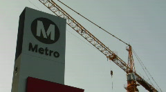 An L.A. Metro train station with crane in background. Stock Footage