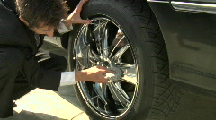 A businessman who made some bad investments ends up working at the car wash. Stock Footage