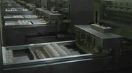 Stock Video Footage of Automated machinery processes cartons of eggs in a factory.
