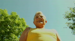 An older man flexes his muscles. Stock Footage