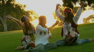 Women sway their arms and bodies at a park. Stock Footage