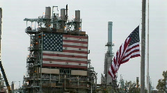 American flags hang at an industrial facility. Stock Footage