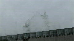 Smoke rises from stacks at a power facility. Stock Footage