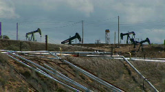 Oil pumps operate in an oil field. Stock Footage