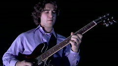 A man plays the guitar. Stock Footage